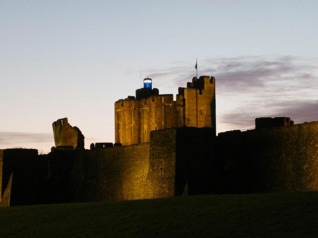 Caerphilly Castle with Dr. Who blue Tardis on the tower floodlit at night