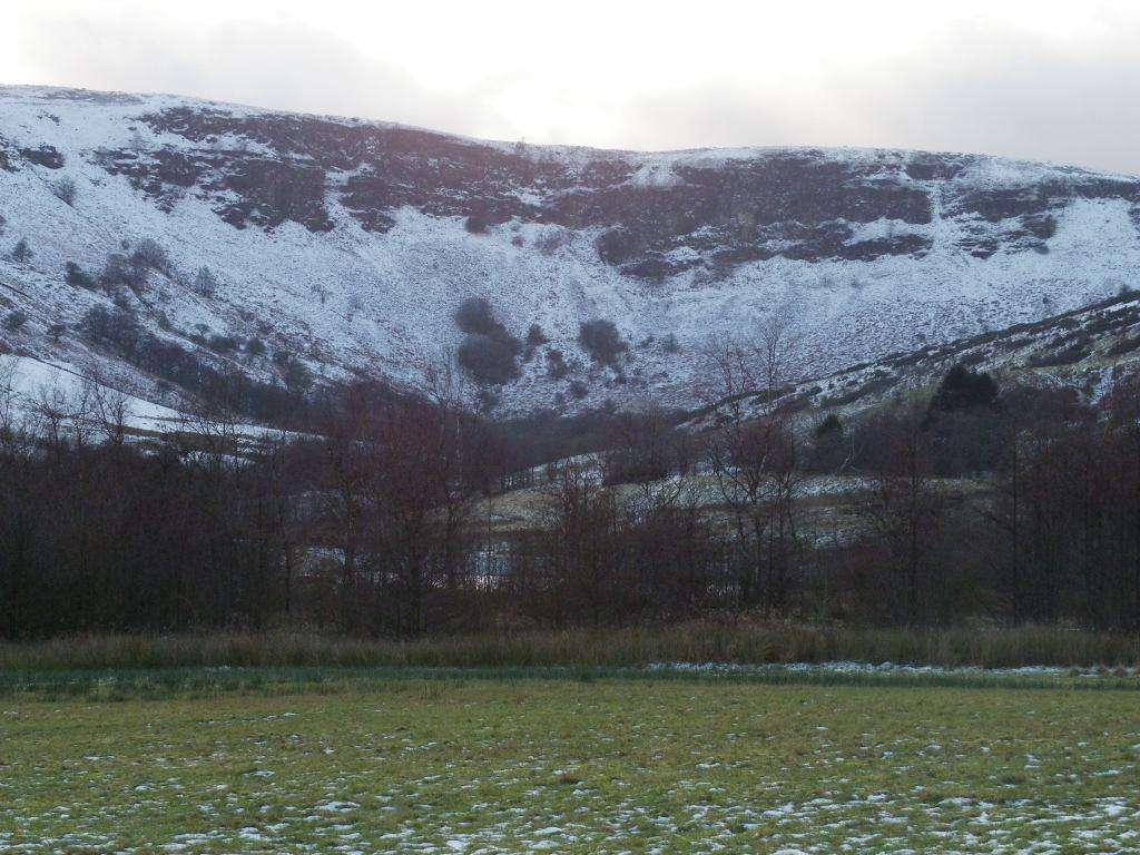 Dare Valley Country Park in Winter surrounded by snow covered mountains