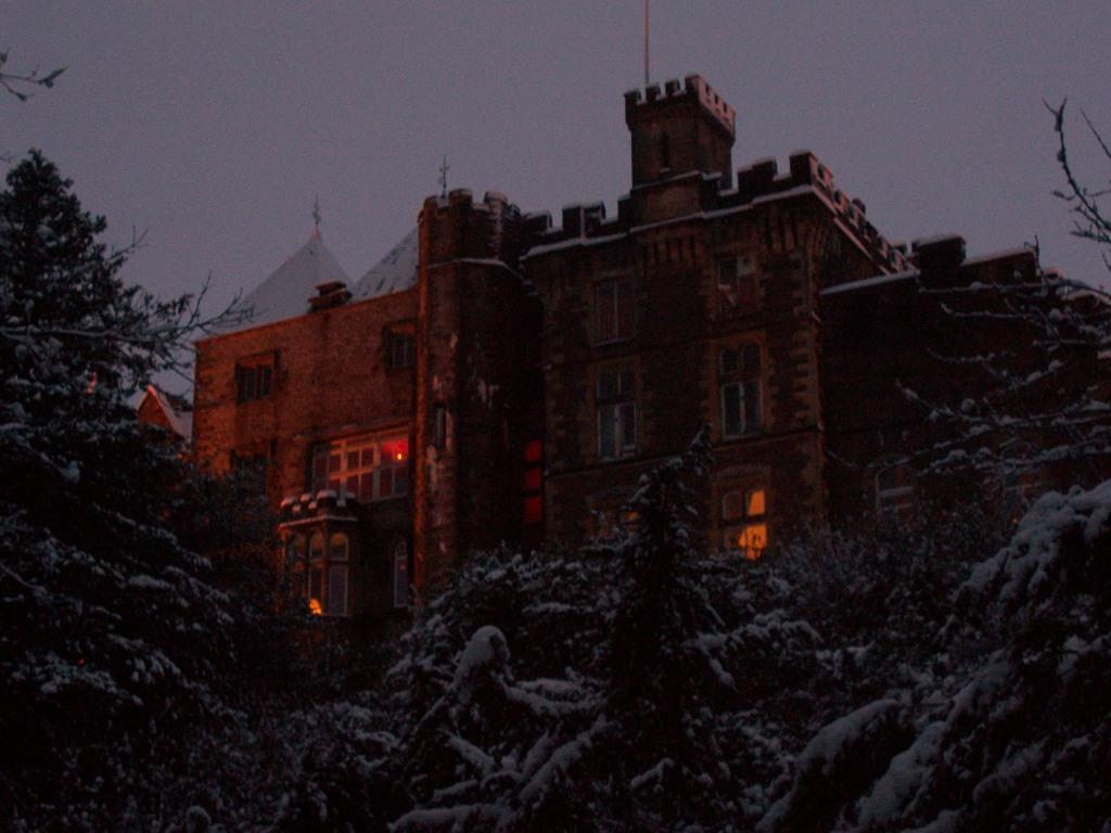 Dog Friendly Hotel Wales, back of Craig y Nos Castle in snow at night