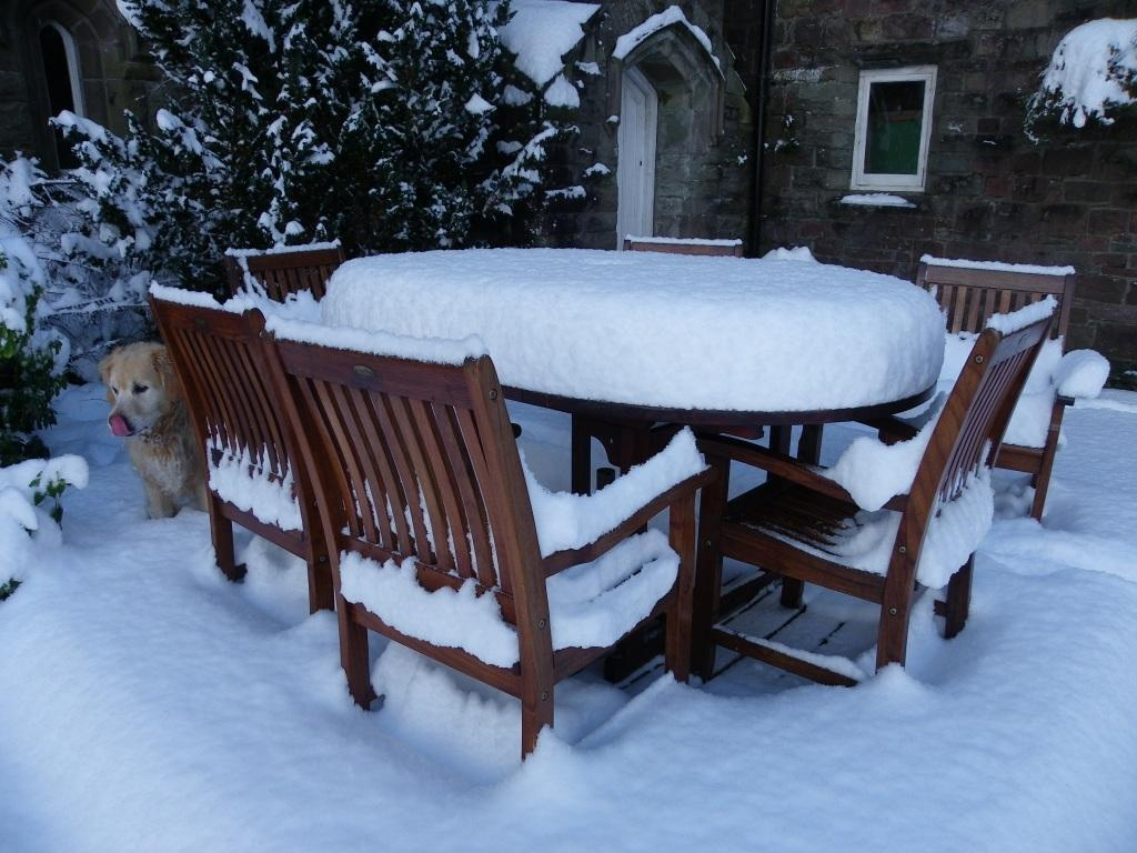 Dog Friendly Hotel Wales, Craig y Nos Castle table and chairs covered in snow