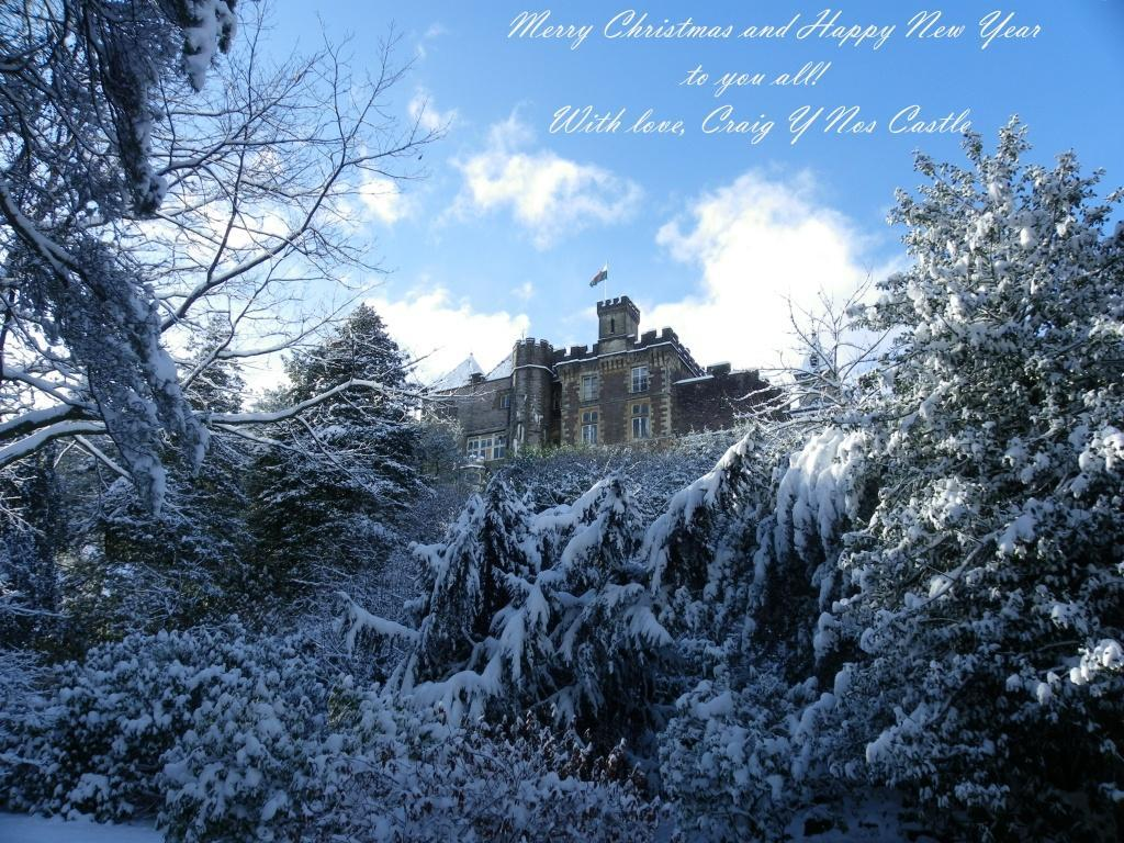 Dog Friendly back of Craig y Nos Castle in snow as seen from lower gardens